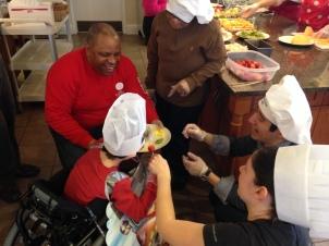 All smiles helping Avery make VC14 Pancake Breakfast Fruit Kabobs