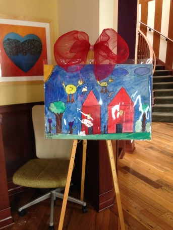 Arts of Life cheerful house painting welcomes guests to the Oak Lawn Ronald McDonald House in celebration of the 2014 Trinity Volunteer Corps Valentine Cheer Project.