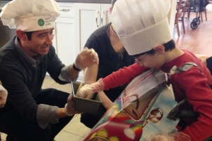 Brian assists Avery Brown our youngest TVC chef in making fruit kabobs.