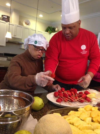 Chef Pals Walter & Greg are busy making bright & beautiful fruit kabobs.