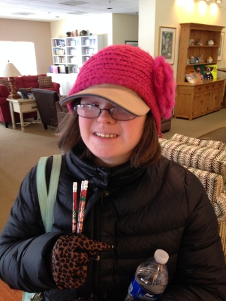 Karina loves her Trinity Volunteers cap and wears it under her winter headgear on a very cold day during our TVC Valentine Cheer 2014.