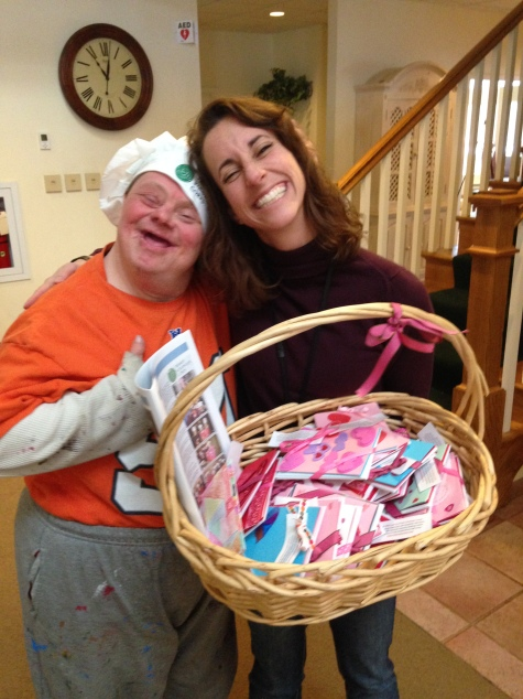 Loyola RMH Director Lisa gets a hug and a smile along with the notecards Trinity Volunteers made for their family welcome bags.