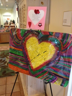 This Arts of Life painting stands near the entrance to the Loyola RMH welcoming visitors with Valentine Cheer and inviting them to enjoy Grandma Mary's Valentine Making Station