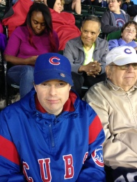 Walter (in the second row) was smiling, dancing and high-fiving when the Sox homered, but Dan, the diehard Cubs fan, was less than excited. However, they were both great hosts for the Little Leaguers.