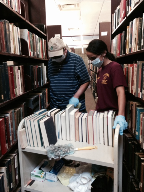 David & Vanessa dusting books in the Dominican University Library