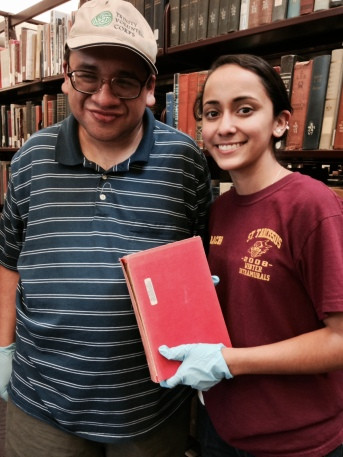 "David & Vanessa send broken books to the ""Book Hospital"" at the library's circulation desk"