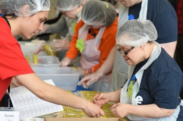We surprised FEED6 organizers when we were able to finish packing all 50,000 meals in record time. We are especially good working together with friends on an assembly line.