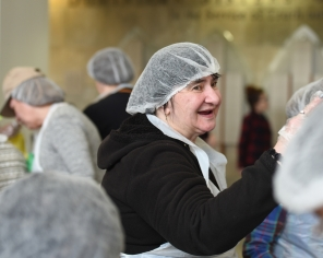 Trinity Volunteer Susan Pasowicz is proud of the opportunity to feed hungry neighbors.