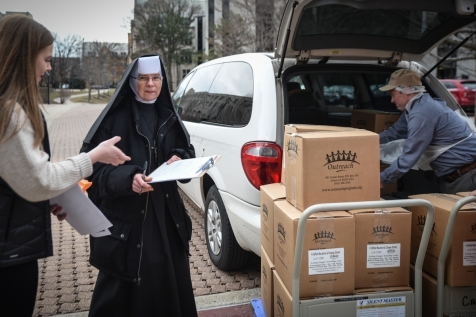 Trinity Volunteer Dan Riley packs the van for St. Blase Food Pantry located in Summit, IL.